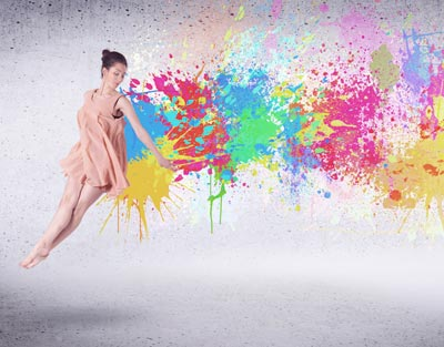 ballerina and spray of different paint colors